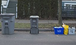 Garbage and Green bins,  recycling boxes,  and recycling bags